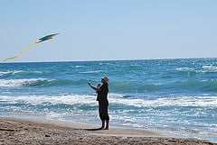 beach kite flying photo