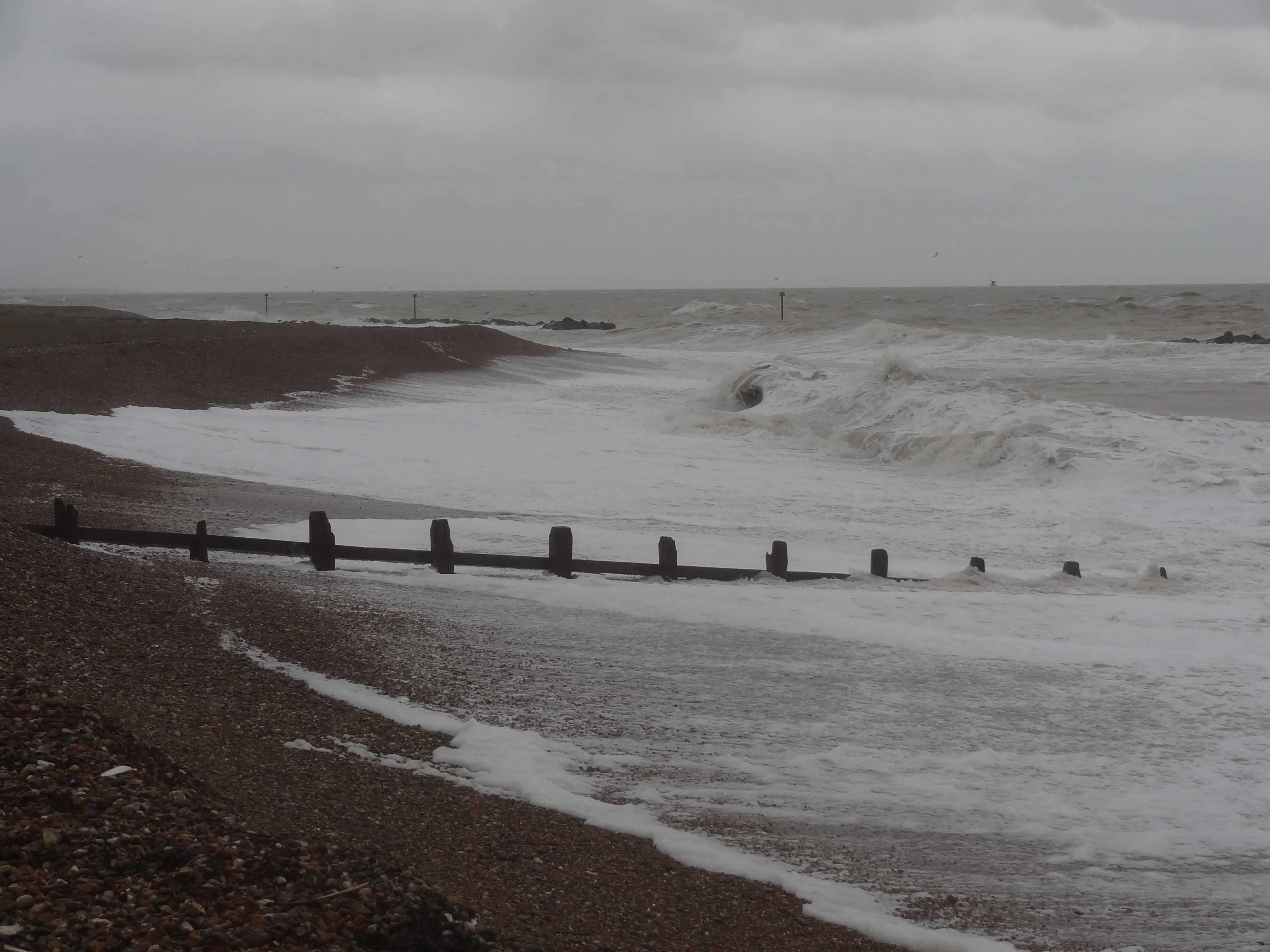 Groynes with waves on West Sussex beach